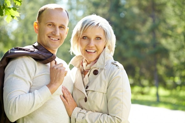 Portrait of loving mature couple, woman is a bit excited